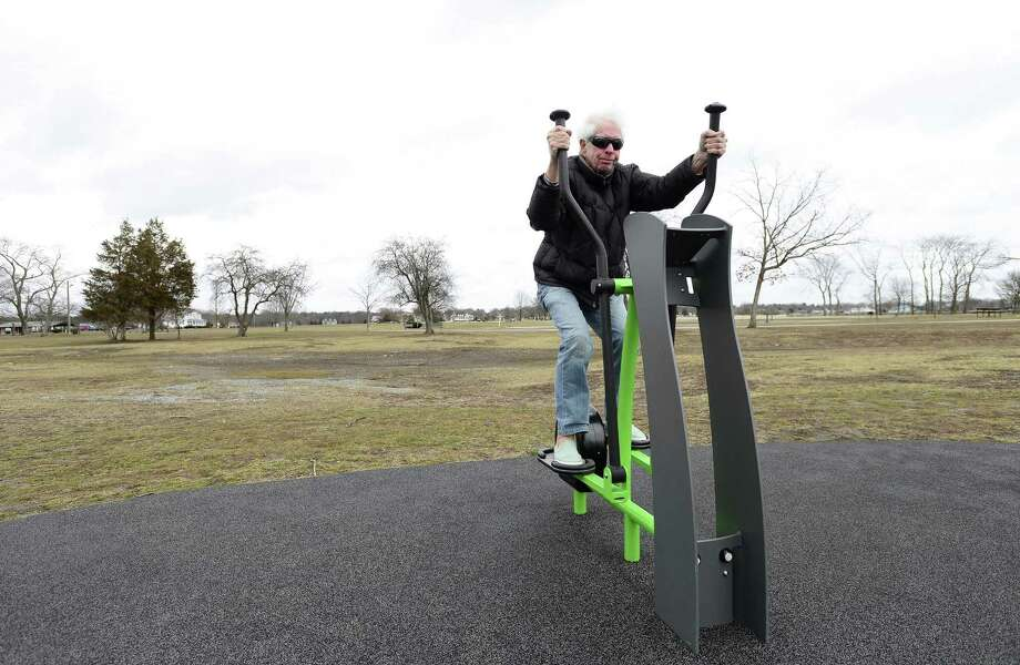 Peter Moss of Darien uses The Cove Island Fit Zone to exercise on March 13 in Stamford. Moss visits the Stamford park daily to walk and exercise. Photo: Matthew Brown / Hearst Connecticut Media / Stamford Advocate