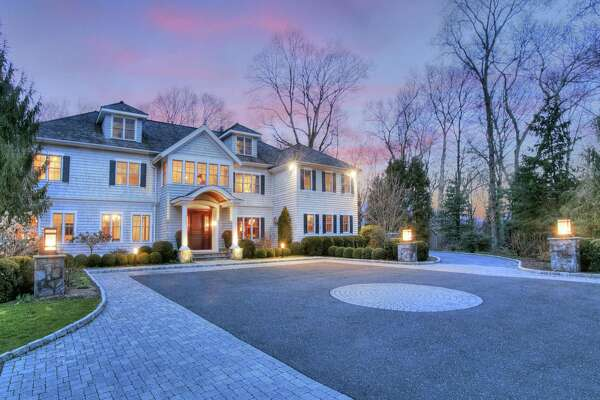 The custom Georgian colonial house at 1671 Ponus Ridge Road has 18 rooms and 9,596 square feet of living space.