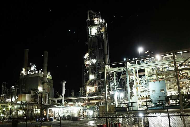 An oil refinery is lit up in the night on Jan. 19, 2016 in Big Spring, Texas.