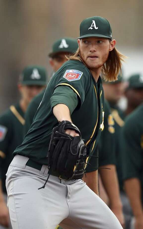 A.J. Puk participates in a spring training baseball drill on Friday, Feb. 16, 2018 in Mesa, Ariz.  Photo: Ben Margot / Ben Margot / Associated Press / Copyright 2018 The Associated Press. All rights reserved.