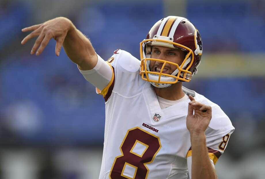 FILE - In this Aug. 29, 2015, photo, Washington Redskins quarterback Kirk Cousins warms up before a preseason NFL football game against the Baltimore Ravens in Baltimore. The Washington Redskins have made a quarterback change: Kirk Cousins will be the starter this season, not Robert Griffin III. (AP Photo/Gail Burton, File) Photo: Gail Burton, AP