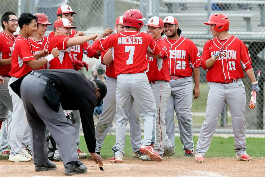 Judson's Caimyn Holiday (7) is greeted at home plate by teammates after hitting a solo home run in the seventh inning during their District 27-6A baseball game with Steele at Steele on Thursday, March 15, 2018.  Judson beat Steele 3-0. MARVIN PFEIFFER/mpfeiffer@express-news.net Photo: Marvin Pfeiffer, Staff / San Antonio Express-News / Express-News 2018