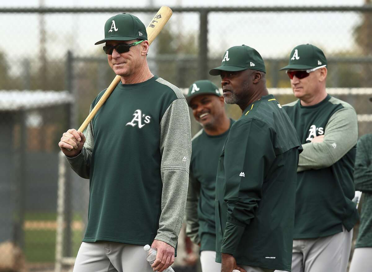 From left, Oakland Athletics manager Bob Melvin, special instructor Dave Stewart, and third base coach Matt Williams oversee a spring training baseball practice on Friday, Feb. 16, 2018 in Mesa, Ariz. (AP Photo/Ben Margot)