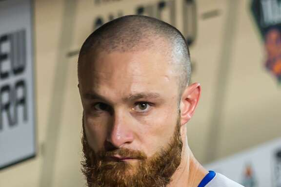 HOUSTON, TX - JUNE 14:  Texas Rangers catcher Jonathan Lucroy (25) prepares in the dugout during the MLB game between the Texas Rangers and Houston Astros on June 14, 2017 at Minute Maid Park in Houston, Texas.  (Photo by Leslie Plaza Johnson/Icon Sportswire via Getty Images)