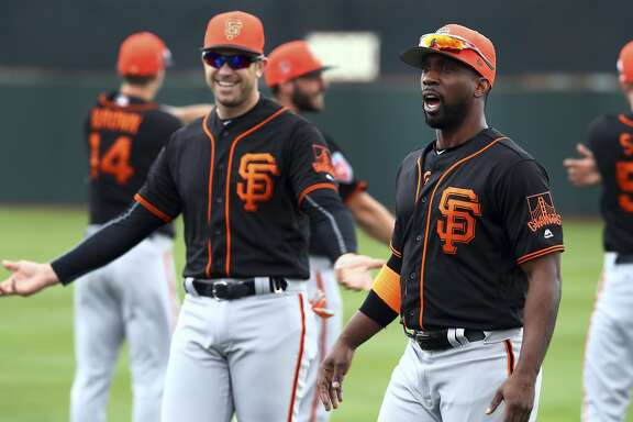 "FILE - In this Feb. 19, 2018, file photo, San Francisco Giants' Andrew McCutchen, right, and Evan Longoria during a spring training baseball practice in Scottsdale, Ariz. Even the new faces of third baseman Longoria and McCutchen understand the pain of losing so many games and the importance of pushing past that to contend again after a 64-98 season. ""I think they're going to be a huge key to our success this year,"" catcher Buster Posey said. (AP Photo/Ben Margot, File)"