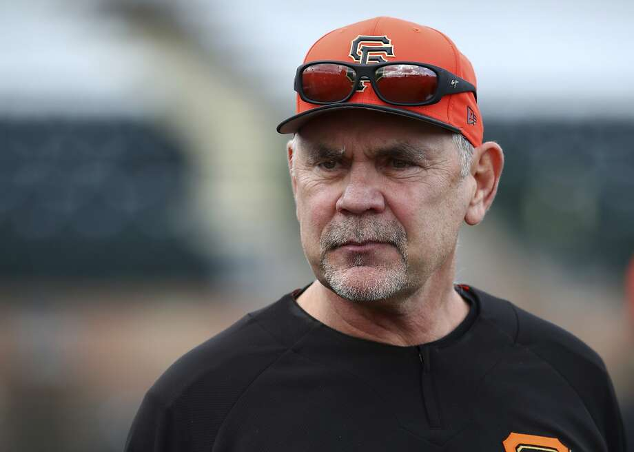 "Giants manager Bruce Bochy oversees a spring training baseball practice in Scottsdale, Ariz. ""You talk to the players and you can see a different attitude coming into this spring with what's happened this offseason,"" manager Bruce Bochy said. ""And also the fact that it's a new slate and we're going to be healthy, so there's a lot of reason to be optimistic."" (AP Photo/Ben Margot, File) Photo: Ben Margot, Associated Press"