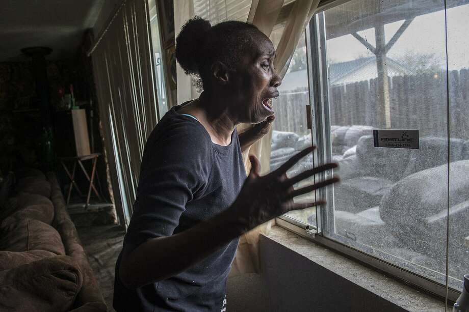 In this March 20, 2018 photo, Sequita Thompson, recounts the horror of seeing her grandson Stephan Clark dead in her backyard after he was shot by police in Sacramento, Calif. Relatives, activists and Sacramento officials are questioning why police shot at an unarmed black man 20 times, killing him, when he turned out to be holding only a cellphone in his grandparents' backyard. Photo: Renee C. Byer, Associated Press