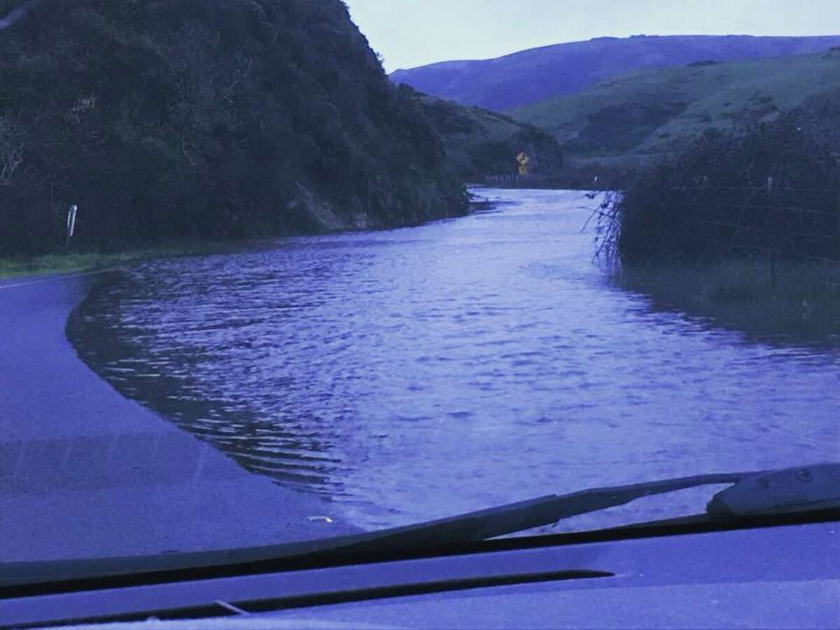 Highway 1 just south of Tomales was flooded after a potent storm delivered heavy rain on March 22, 2018.