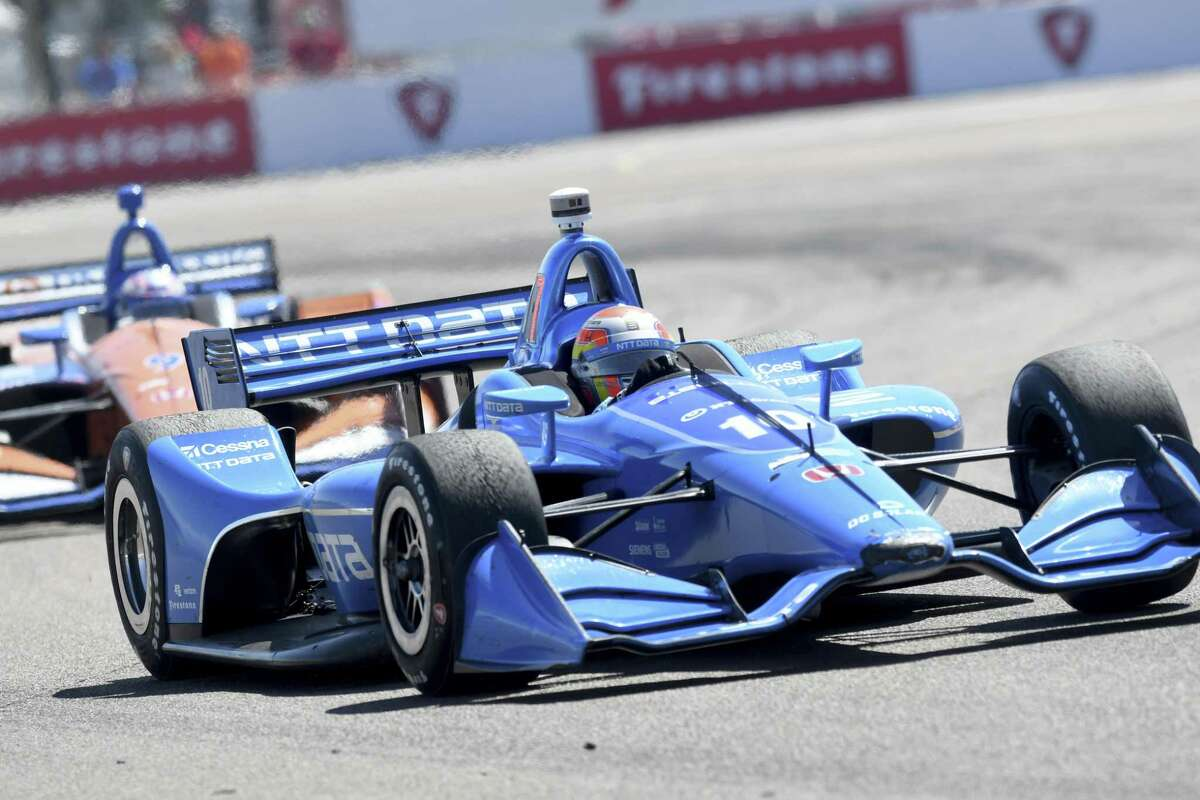 Ed Jones (10) races into turn two during the IndyCar Firestone Grand Prix of St. Petersburg Sunday, March 11, 2018, in St. Petersburg, Fla. (AP Photo/Jason Behnken)
