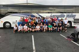 ServeUp volunteers from New England pose in front of the bus that will transport them to sites around the greater Houston area in need of Harvey-related restoration and rebuild efforts.