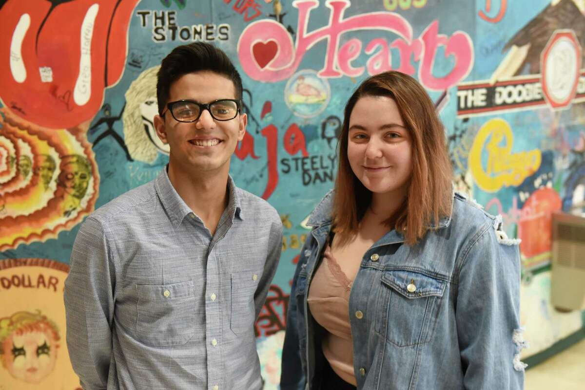 Schalmont High School students Hamza Noor, left, and Kaelyn Dicocco stand in front of a mural in their school on Thursday, March 22, 2018 in Schenectady, N.Y. The two students are helping organize the March for Our Lives in Albany happening this Saturday March 24th. (Lori Van Buren/Times Union)