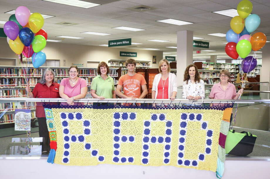 The Walk Across Texas Central Library team from the left: April Chastain, Kimberly Milliff, Devery Johnson, Kevin Johnson, Laura Robinson, Sylvia Huerta and Deb Horwedel pose for a photo on Tuesday, June 20, 2017, at the Montgomery County Central Library. This year's Walk Across Texas challenge begins on April 1. Photo: Michael Minasi, Staff Photographer / Internal
