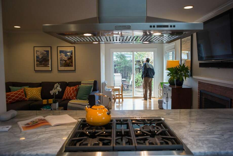 Broker Manuel Macias tours an open house on McKinley Ave. in Sunnyvale. Median home prices in Santa Clara County rose an extraordinary 27.8 percent in February from a year earlier, according to CoreLogic. Photo: James Tensuan, Special To The Chronicle
