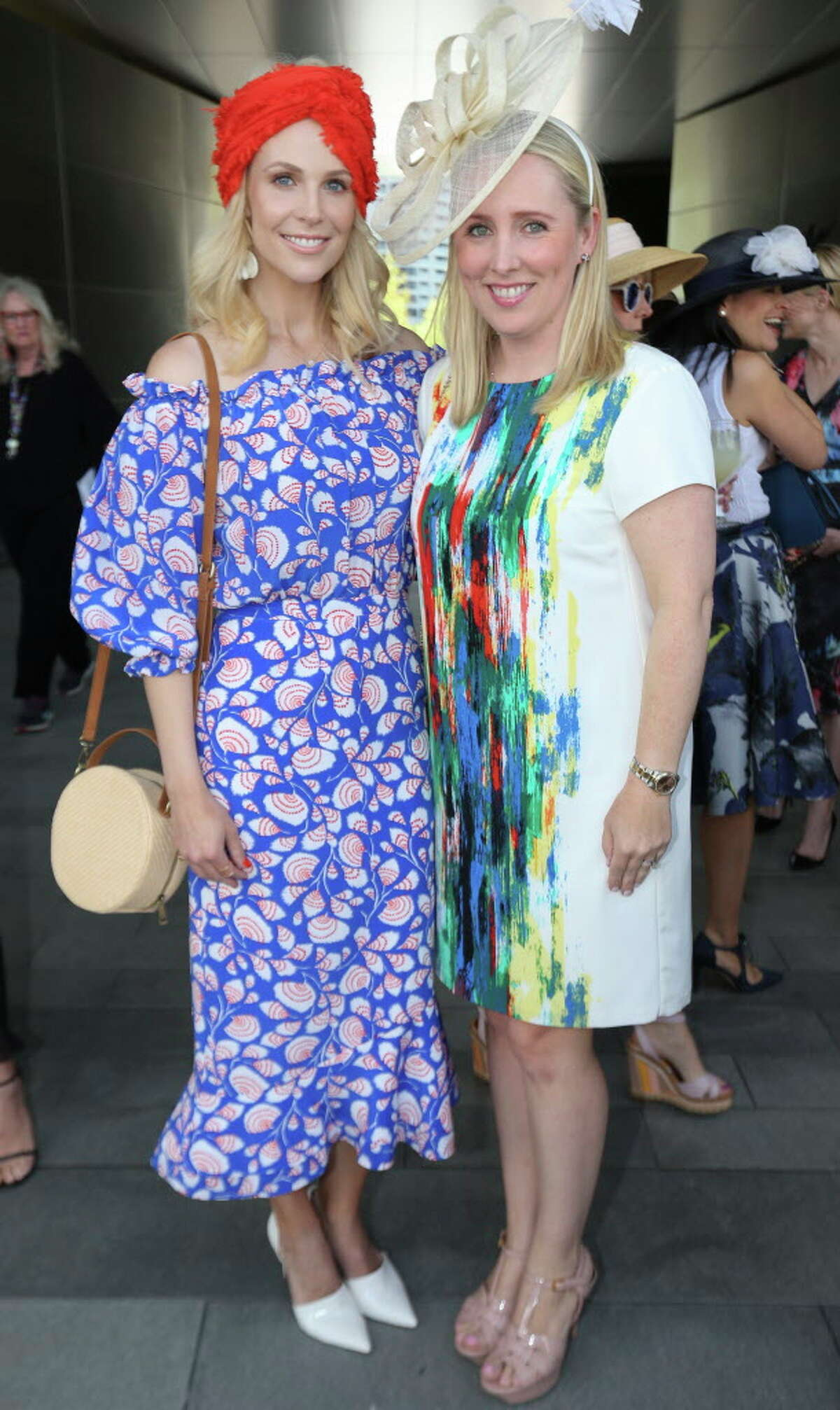 Kathleen Jennings, left, and Liz Anders pose for a photograph at the Hats in the Park luncheon at the Cherie Flores Garden Pavilion on Thursday, March 22, 2018, in Houston.