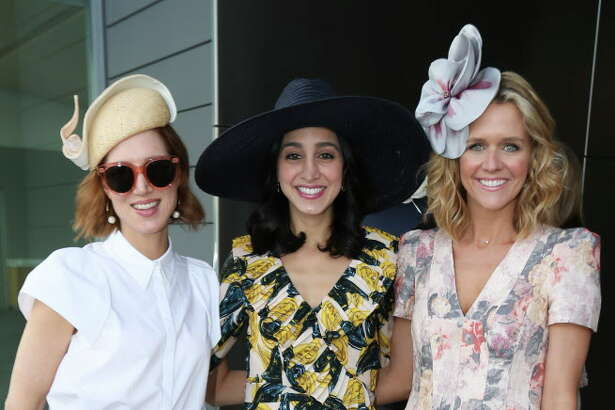 Carolyn Dorros, from left, Holly Radom and Lyndsey Zorich pose for a photograph at the Hats in the Park luncheon at the Cherie Flores Garden Pavilion on Thursday, March 22, 2018, in Houston.