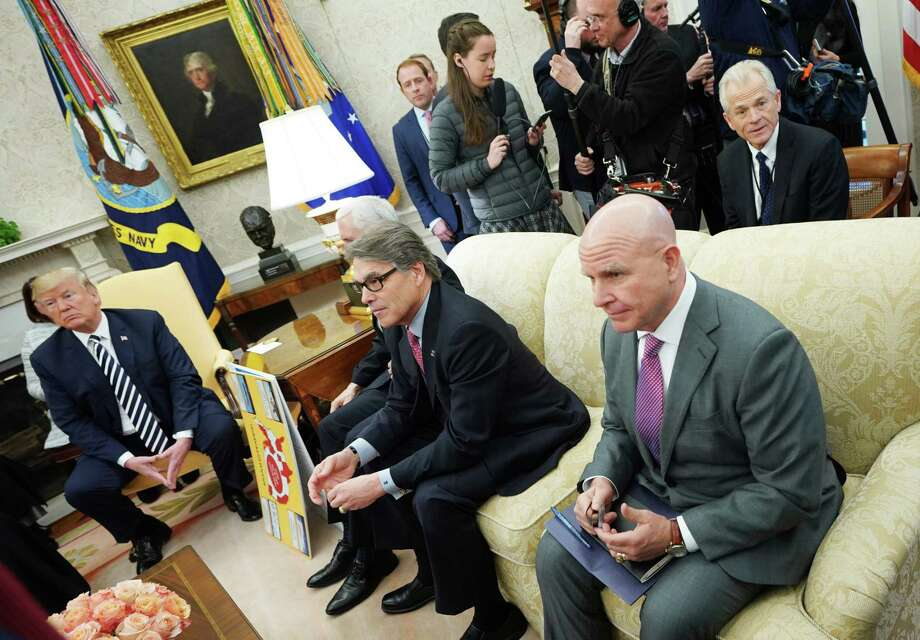 """From left: US President Donald Trump, Energy Secretary Rick Perry, and National Security Advisor H.R. McMaster (R) attend a meeting with Saudi Arabia's Crown Prince Mohammed bin Salman in the Oval Office of the White House on March 20, 2018 in Washington, DC. At right seated behind the sofa is Director of the White House National Trade Council Peter Navarro. The Trump administration and Energy Secretary Rick Perry are trying to revive a U.S. nuclear industry that has not built reactors with any regularity in decades and pursue their policy of American """"energy dominance."""" Photo: MANDEL NGAN /AFP /Getty Images / AFP or licensors"""