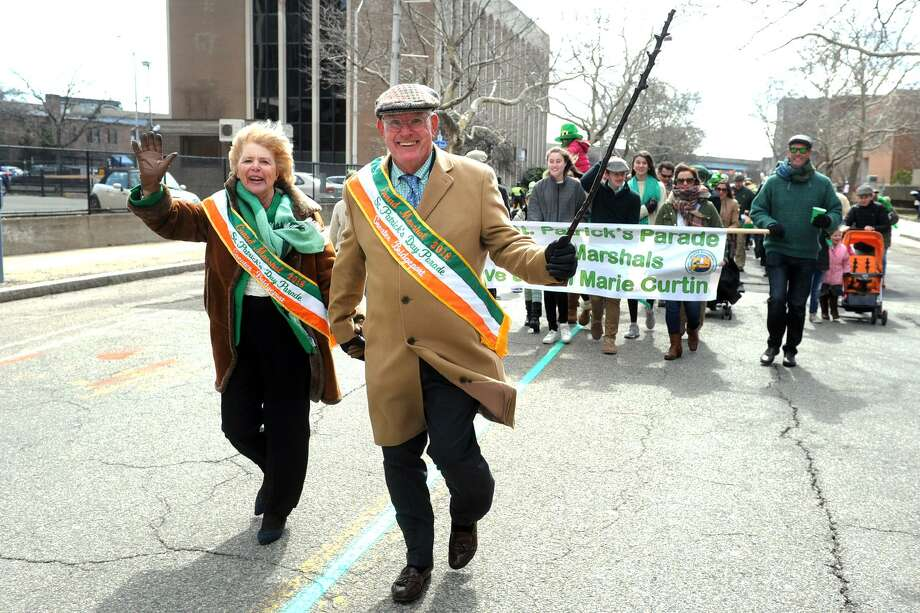 Grand Marshals Ann Marie and Dave Curtin, of Fairfield, march in the Greater Bridgeport St. Patrick's Day Parade, in Bridgeport, Conn. March 16, 2018. Photo: Ned Gerard / Hearst Connecticut Media / Connecticut Post