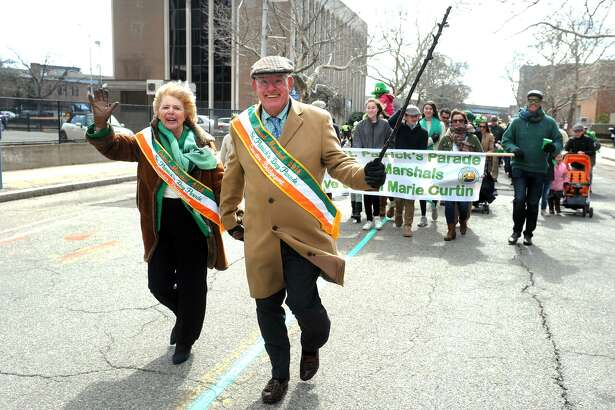 Grand Marshals Ann Marie and Dave Curtin, of Fairfield, march in the Greater Bridgeport St. Patrick's Day Parade, in Bridgeport, Conn. March 16, 2018.