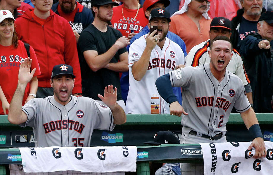 FILE - In this Oct. 9, 2017, file photo, Houston Astros relief pitcher Justin Verlander, left, and third baseman Alex Bregman cheer after Josh Reddick hit an RBI single in the eighth inning in Game 4 of the baseball team's American League Division Series against the Boston Red Sox in Boston. Soon after the Astros won the World Series, Bregman learned that Verlander wasn't simply a late-season rental but was under contract with the team for two more seasons. Bregman's reaction, which was caught on a teammate's Instagram Live account, was one of pure glee as he repeatedly shrieked and hollered with an immovable grin on his face. (AP Photo/Michael Dwyer, File) Photo: Michael Dwyer, STF / AP2017