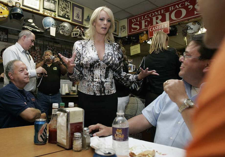 Actress Stormy Daniels talks with customers at a New Orleans restaurant in 2009. She alleges she had a sexual tryst with Donald Trump, which he denies. Photo: Bill Haber / Associated Press 2009