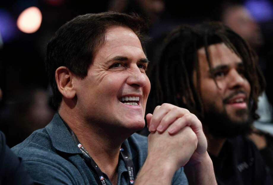 "FILE - In this Saturday, Feb. 17, 2018 file photo, Dallas Mavericks owner Mark Cuban watches from the crowd during NBA All-Star Saturday in Los Angeles. When the Dallas owner went on Hall of Famer Julius Erving's podcast in February and said he told his players that ""losing is our best option,"" the league fined him $600,000 for ""public statements detrimental to the NBA."" That put a spotlight on the Mavericks. So if they were planning on packing it in and trying to add more young legs in the draft for Nowitzki's expected swan song, suddenly they had to change plans. (AP Photo/Chris Pizzello, File) Photo: Chris Pizzello, STF / Invision"