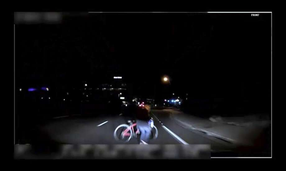 Dashcam video from Sunday night shows Elaine Herzberg as she crosses the road with a bicycle, walking across the Uber vehicle's lane. Why the car apparently failed to take action to stop is still unknown. Photo: Associated Press