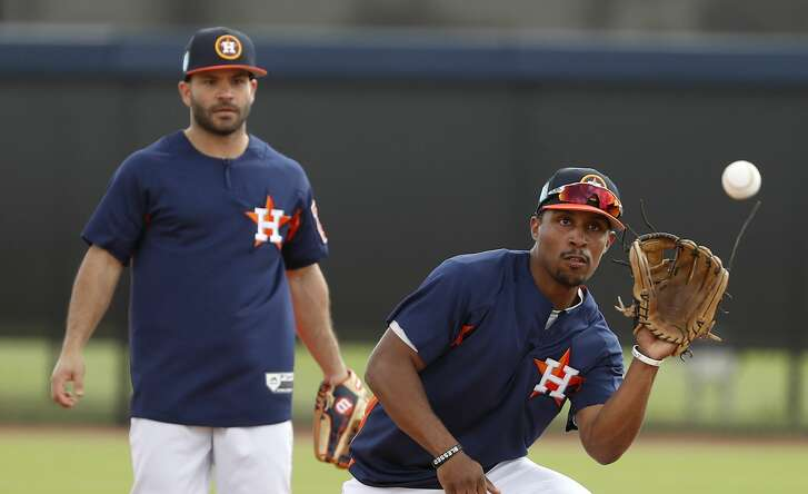 Houston Astros outfielder Tony Kemp (18) fields the ball during a drill during spring training at The Ballpark of the Palm Beaches, Tuesday, Feb. 20, 2018, in West Palm Beach.   ( Karen Warren / Houston Chronicle )