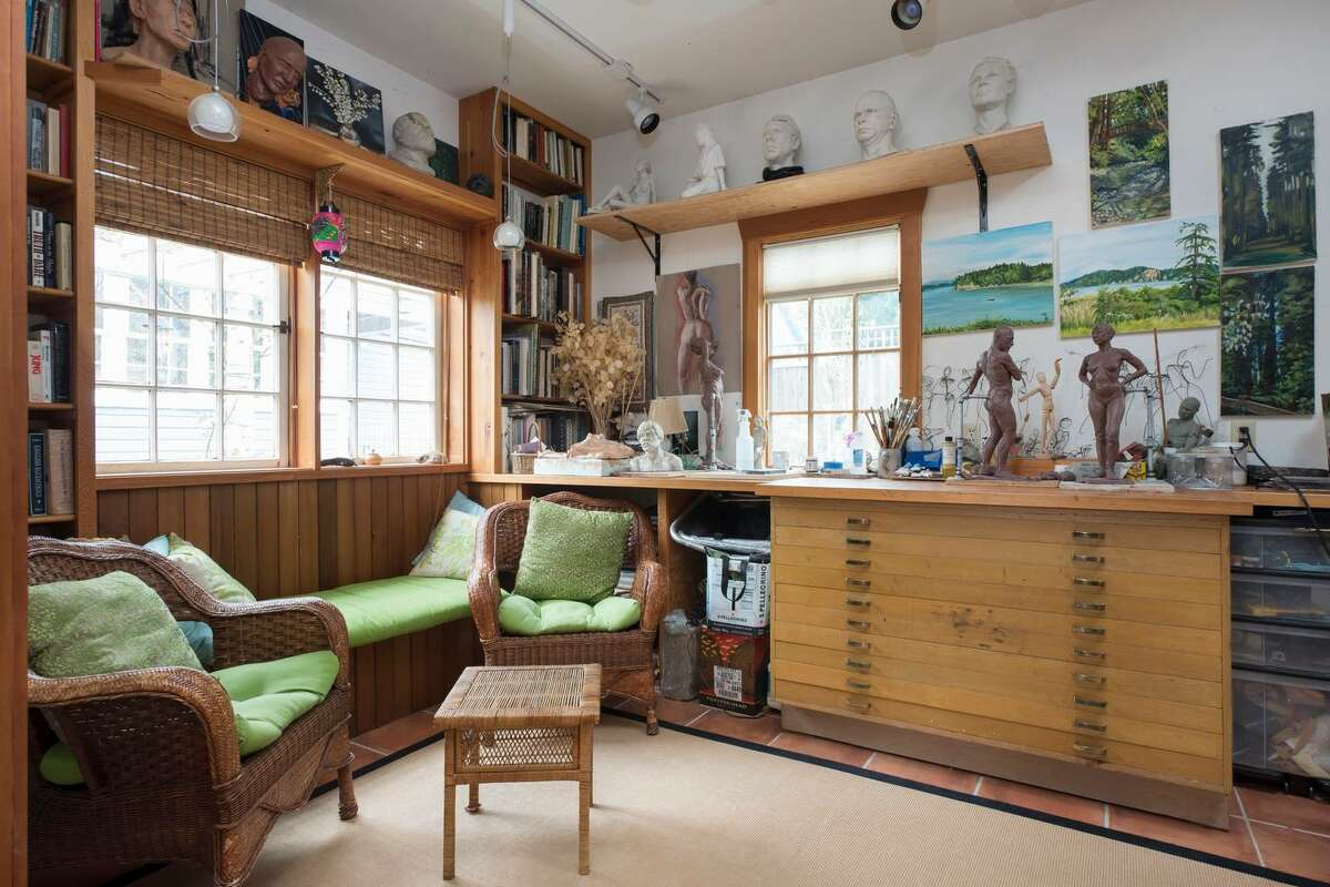 This Ballard abode is an obvious artists' retreat. The cottage nestled behind a Victorian house is all yours.