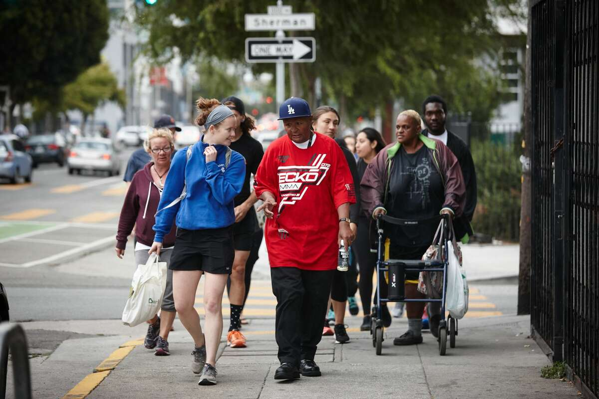 Back on My Feet members and volunteers on an early-morning team run in San Francisco. The organization that employs running to give homeless people confidence serves 12 cities and opened in S.F. in October 2016.