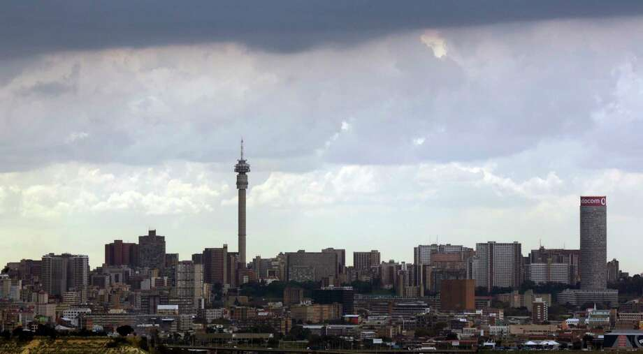 "In this March 20, 2018 photo, Johannesburg's skyline is shown under the clouds in South Africa. The blockbuster film ""Black Panther"" has created a new compelling vision of Africa as a continent of smart, technologically savvy people with cool clothes living in a futuristic city amid stunning landscapes. (AP Photo/Themba Hadebe) Photo: Themba Hadebe / Copyright 2018 The Associated Press. All rights reserved."