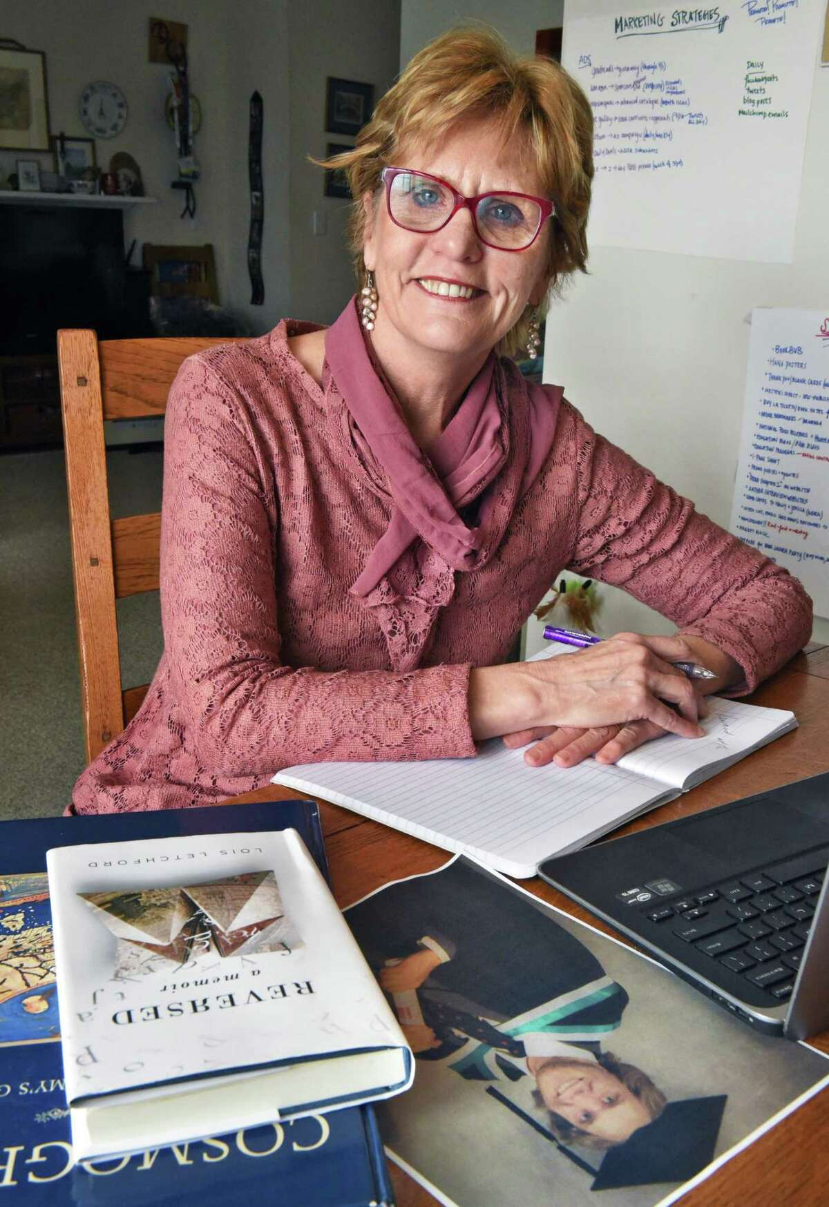 Author Lois Letchford at her dining room table work station Thursday March 15, 2018 in Green Island, NY. Her book,
