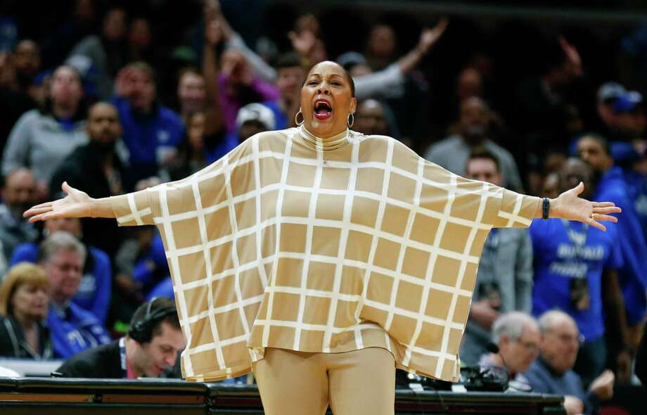 """FILE - In this March 10, 2018, file photo, Buffalo head coach Felisha Legette-Jack reacts to a foul call during the second half of an NCAA college basketball game against Central Michigan in the championship of the Mid-American Conference tournament, in Cleveland. Once her coaching career collapsed at Indiana, and Felisha Legette-Jack considered walking away from basketball entirely, she made one promise if ever another opportunity arose. Upon being hired to take over Buffalo's flagging women's basketball program in 2012, Legette-Jack vowed she was going to be her bold, brash, boisterous self rather than attempt fitting someone else's prim and boxy notion of how a coach is supposed to behave. """"Yeah, I was afraid to be me,"""" Legette-Jack told The Associated Press this week. Photo: Ron Schwane, AP / AP 2018"""