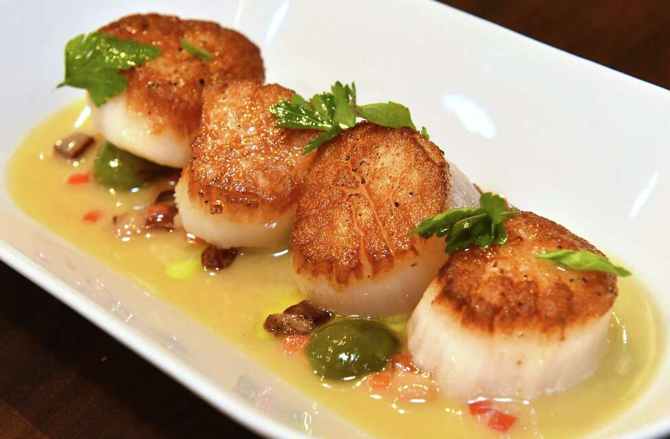 Scallops and Speck, scallops, castelvetrano olives, crispy speck, herbs at Vintage on Wednesday, March 14, 2018 in Albany, N.Y. (Lori Van Buren/Times Union)