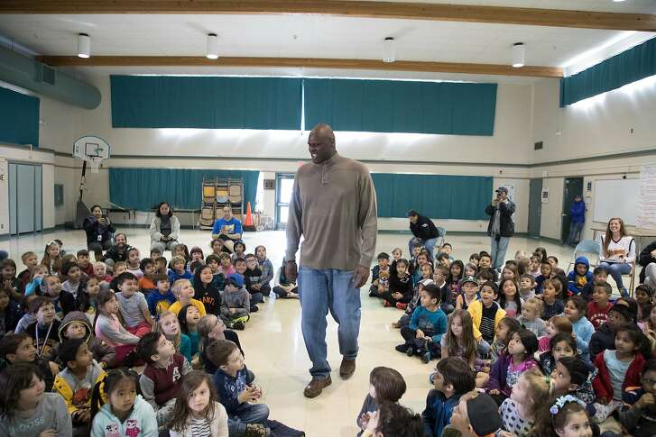 """Adonal Foyle, 6'10"""", arrives at elementary school on Thursday, March 22, 2018 in Concord, CA."""
