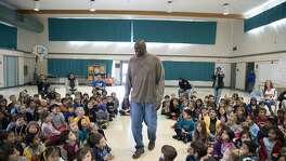 "Adonal Foyle, 6'10"", arrives at elementary school on Thursday, March 22, 2018 in Concord, CA."