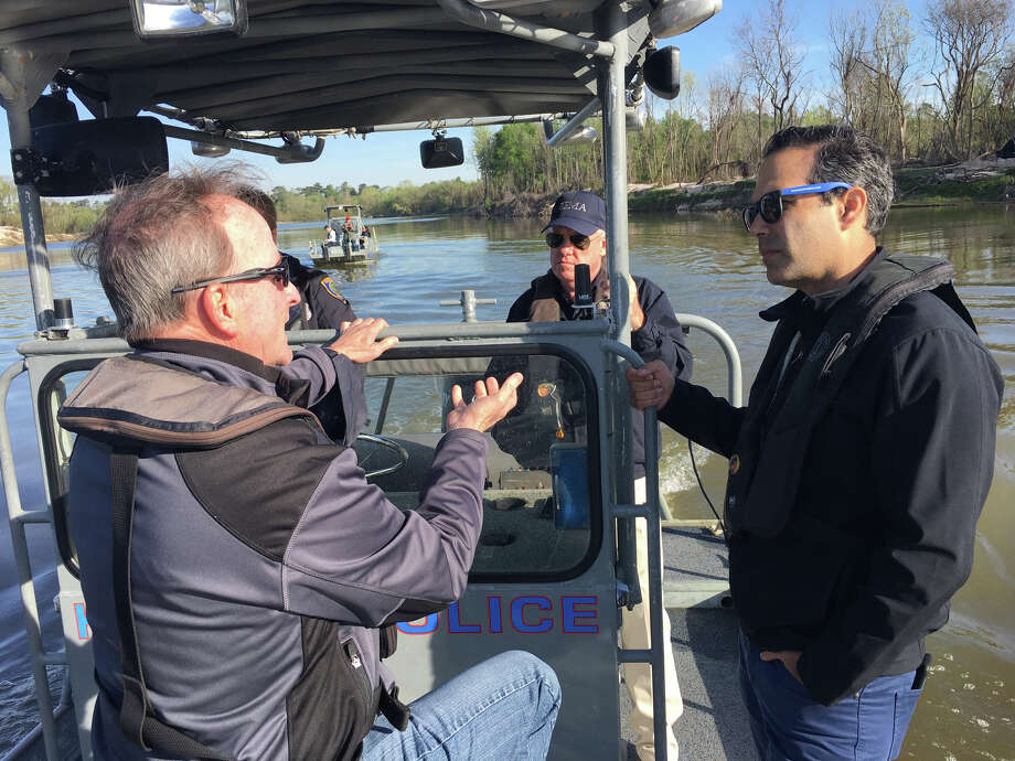 Council Member Dave Martin discusses the Lake Houston area's post-Harvey needs with Texas Land Commissioner George P. Bush during a boat tour along the San Jacinto River on Thursday, March 22. Photo: Courtesy Of The Texas General Land Office