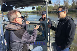 Council Member Dave Martin discusses the Lake Houston area's post-Harvey needs with Texas Land Commissioner George P. Bush during a boat tour along the San Jacinto River on Thursday, March 22.