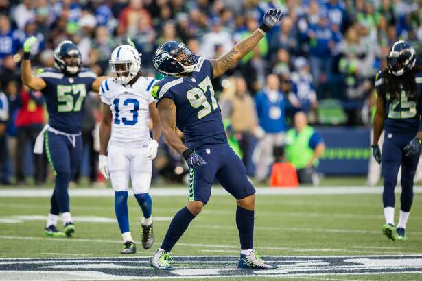 SEATTLE, WA - OCTOBER 01: Defensive end Marcus Smith (97) of the Seattle Seahawks celebrates a tackle in the first half during a game between the Seattle Seahawks and the Indianapolis Colts on October 01, 2017 at CenturyLink Field in Seattle, WA. (Photo by Christopher Mast/Icon Sportswire via Getty Images)