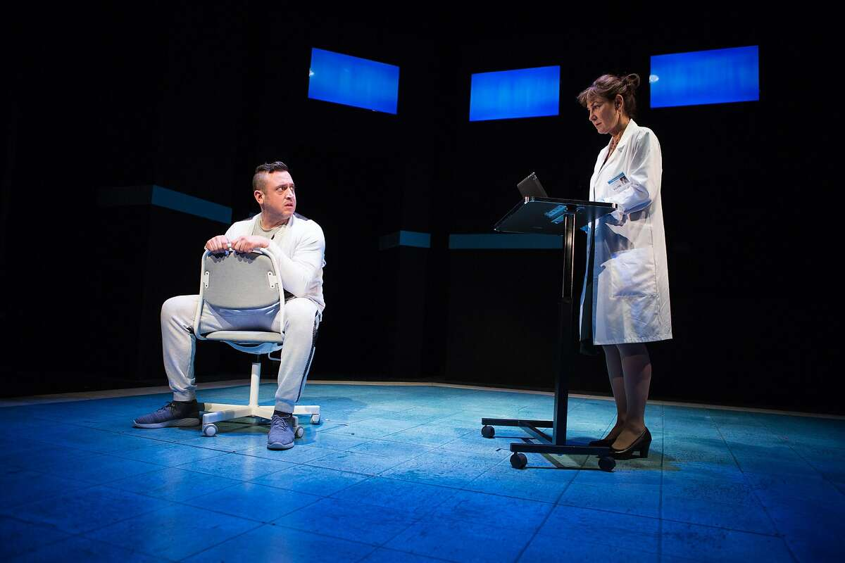 Tristan Frey (Joe Estlack) and Dr. Lorna James (Susi Damilano) discuss side effects in �The Effect� at San Francisco Playhouse.