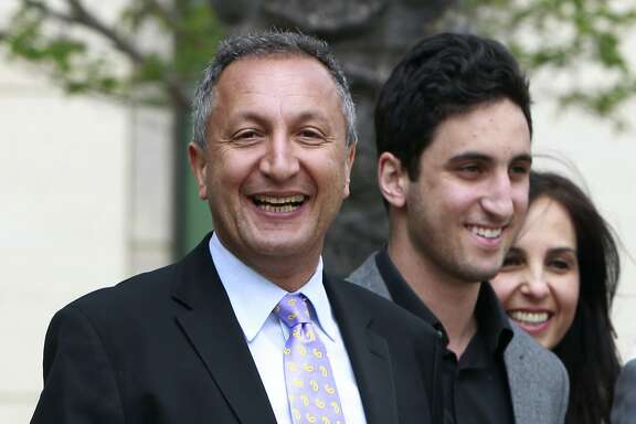 FILE - In this April 21, 2011 file photo shows MGA chief executive Isaac Larian, left, leaves federal court in Santa Ana, Calif., after a victory over Mattel Inc. The CEO of the maker of the pouty Bratz dolls is launching a campaign to salvage some of Toys R Us' U.S. business being liquidated in bankruptcy. (AP Photo/Christine Cotter, File)