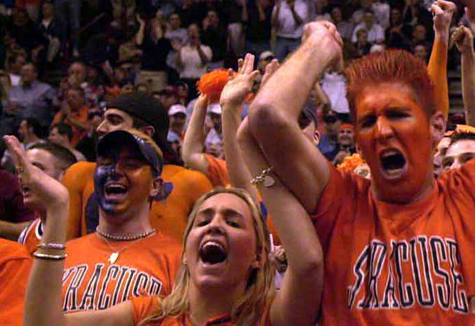 Times Union photo by STEVE JACOBS, 3/28/03, Albany,NY-- NCAA ACTION -- Syracuse University fans cheer their team during the NCAA basketball tournament in the Pepsi Arena, Friday night, March 28,2003 ( for story)