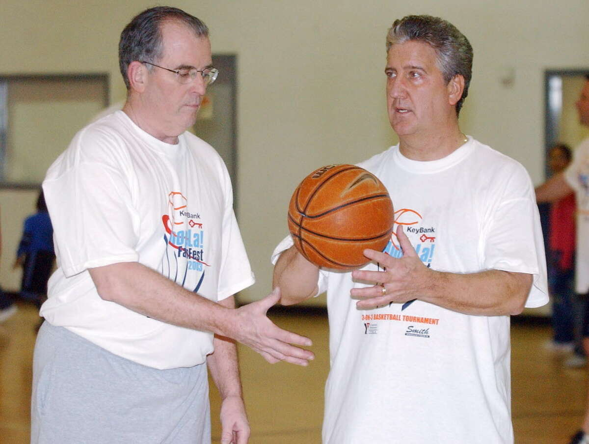 Albany County Executive Mike Breslin and Albany Mayor Jerry Jennings warm up before a 3-on-3 basketball game that opened the 3-on-3 basketball tournament in conjunction with the NCAA East Regional at the Pepsi Arena on Feb. 18, 2003.