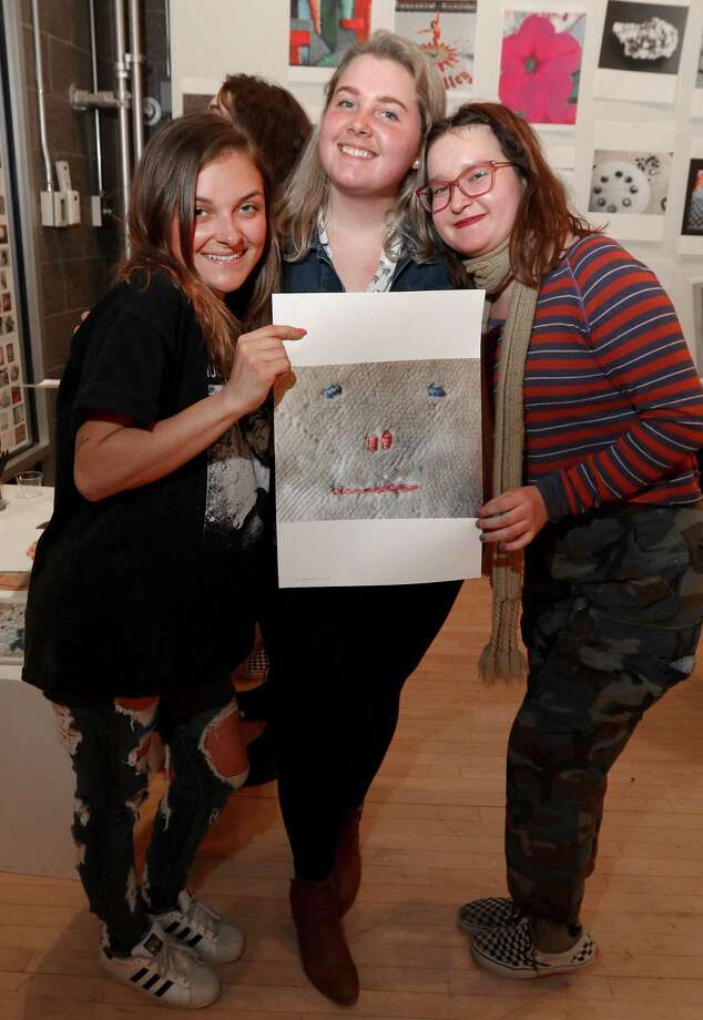 Albany, NY - March 16, 2018 - (Photo by Joe Putrock/Special to the Times Union) - (l to r) Victoria Stockman, Madison Scisci and Lea Diep hold a piece of work by exhibiting photographer Polly Apfelbaum during The 40th Annual Photo Regional: Effects That Aren't Special opening reception at the Opalka Gallery on the Sage College of Albany campus. Photo: Joe Putrock / Joe Putrock