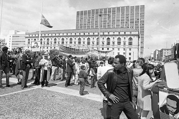 People gather for memorial at Civic Center the day Martin Luther King was assassinated, April 5, 1968. King had previously come to the Bay Area to take people to task for supporting segregated housing laws -- an issue that's still affecting us today.