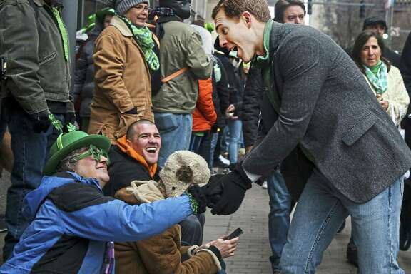 Revelers shakes hands with Democrat Conor Lamb during the Pittsburgh St. Patrick's Day Parade on Saturday. Lamb won the special election in the 18th Congressional District, a win that Republicans should take as an omen, according to a reader.