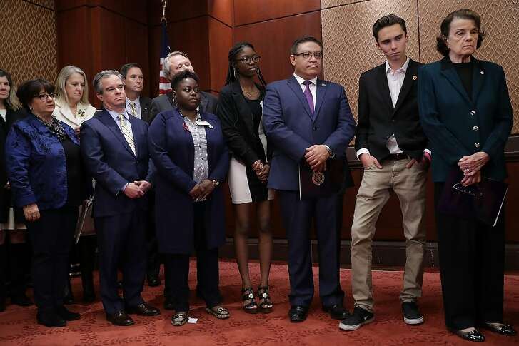 WASHINGTON, DC - MARCH 22:  Sen. Dianne Feinstein (D-CA), Rep. Salud Carbajal (D-CA), Marjory Stoneman Douglas High School shooting survivors Aalayah Eastmond, David Hogg and Diana Perri and other advocates for gun control reform hold a news conference in the U.S. Capitol Visitors Center March 22, 2018 in Washington, DC. Organized by the Brady Campaign to Prevent Gun Violence and Prosecutors Against Gun Violence, the participants outlined their three-point legislative plan to curb gun violence just days before the March For Our Lives.  (Photo by Chip Somodevilla/Getty Images)