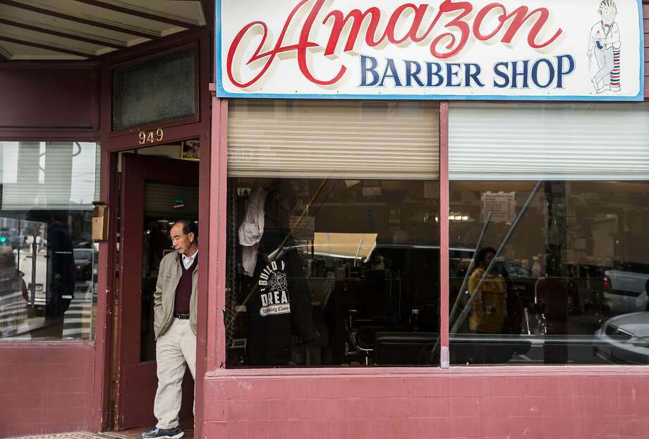 A man exits the Amazon Barber Shop Thursday, March 22, 2018 in San Francisco, Calif. following a shooting that injured one police officer and five others at the shop Wednesday, March 21. Photo: Jessica Christian / The Chronicle