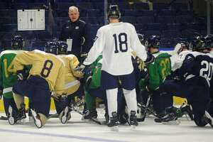 Notre Dame Head Coach Jeff Jackson talks with his team during practice for the NCAA East Regional hockey tournament at the Webster Bank Arena in Bridgeport, Conn. on Thursday, March 22, 2018.