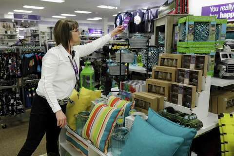 13aa6bbf54a Angie Nelson organizes a display at the new Gordmans discount department  store in Rosenberg