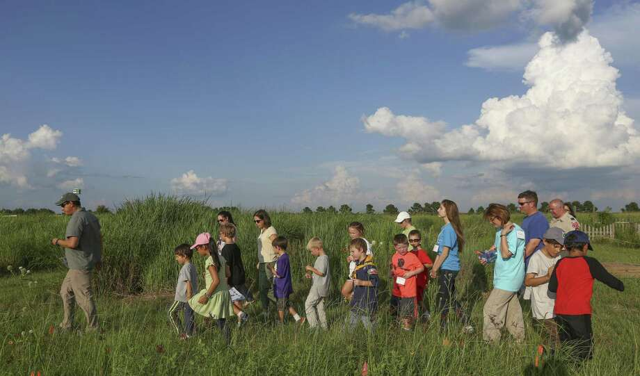 Children enjoy a field trip at the Katy Prairie Conservancy's Indiangrass Preserve in Waller. Photo: Steve Gonzales / Houston Chronicle / © 2016 Houston Chronicle
